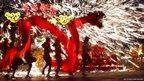 Dancers perform a fire dragon dance