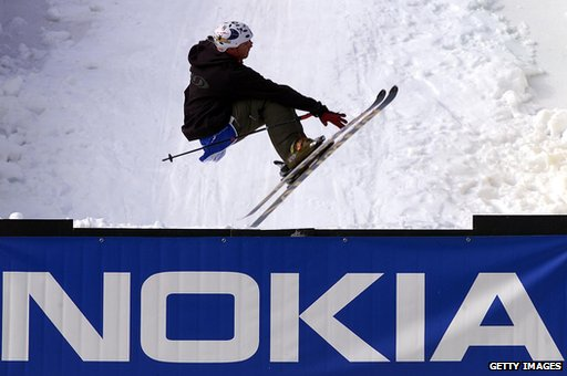 Skiier jumps over Nokia advertising