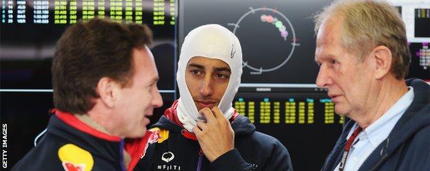 Red Bull team principal (left) talks with driver Daniel Ricciardo (centre) and motorsport consultant Dr Helmut Marko.