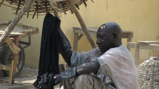 Indigo dyer at work in Kano, Nigeria