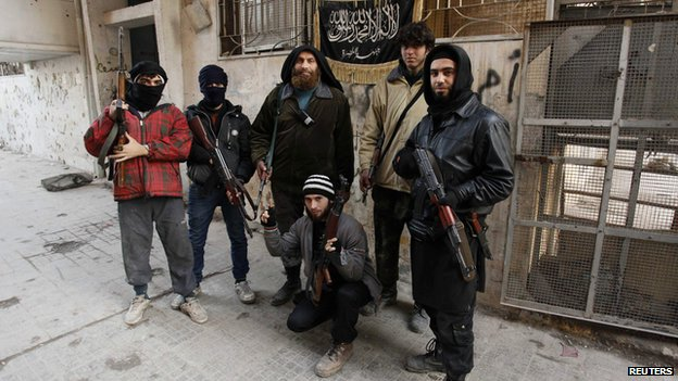 Members of the Al-Nusra Front - part of al-Qaeda - which has recruited British jihadists, here in Aleppo