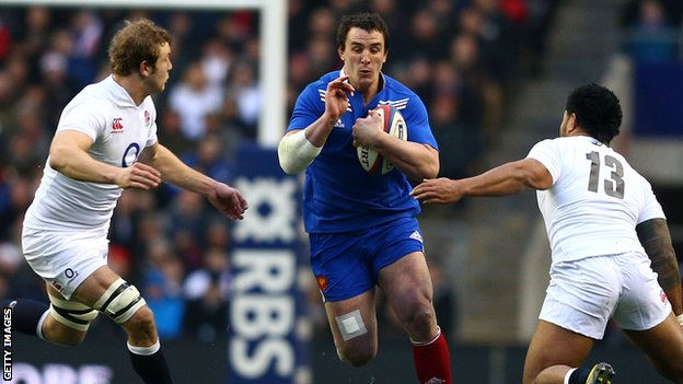 Louis Picamoles takes on Joe Launchbury and Manu Tuilagi of England in 2013