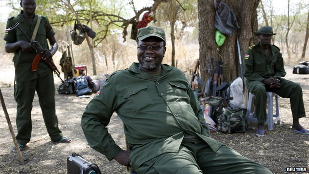 South Sudan's rebel leader Riek Machar sits near his men in a rebel-controlled territory in Jonglei State (January 31, 2014)