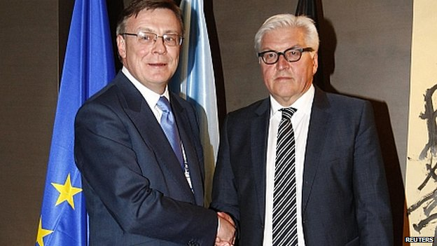 Foreign Minister Frank-Walter Steinmeier, right, and Ukraine's Foreign Minister Leonid Kozhara