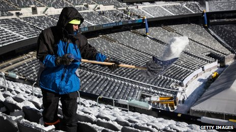 Man clears snow from the Superbowl stadium in New Jersey