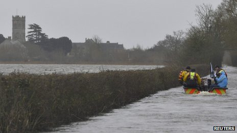 Boat travels through floodwater in the Somerset Levels
