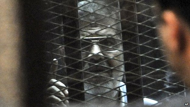 Mohammad Morsi in court on 28 Jan 2014