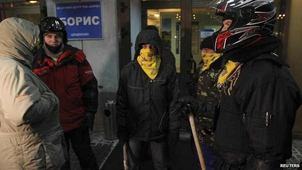 Opposition activists stand guard near the entrance to a private hospital where activist Dmytro Bulatov is being treated in Kiev, Ukraine, 31 Jan