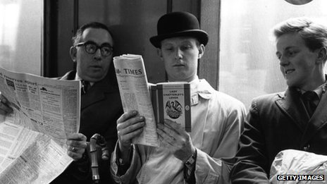 Man reading on the Tube in 1960