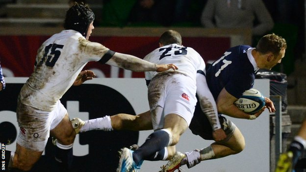 Byron McGuigan goes over to score for Scotland