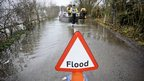 flood sign and boat in background