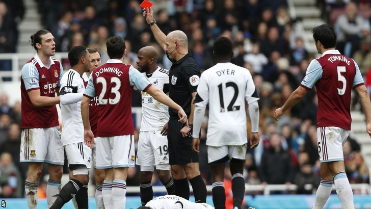 Andy Carroll is sent off by referee Howard Webb