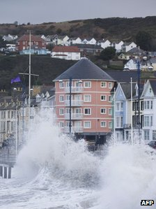 Winds lash the waves up onto the promenade during high tide in Aberystwyth
