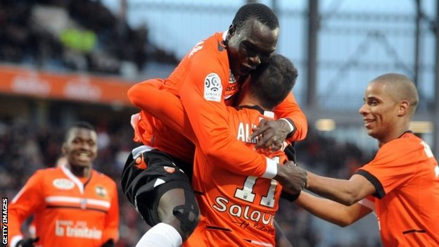 Lorient French forward Jeremie Aliadiere (second right) is congratulated by team-mates
