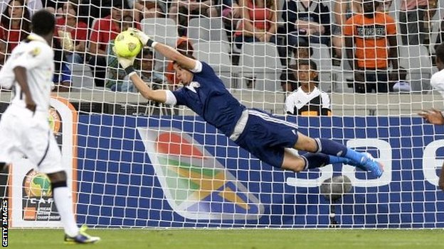 Libyas goalkeeper Nashnush saves during the African Nations Championship final