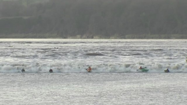 Canoeists brave the Severn Bore