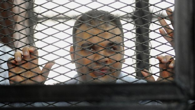 File photo of Mohamed Badr in jail (4 December 2013)