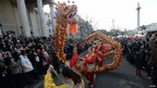 A dragon is carried during a parade celebrating Chinese New Year