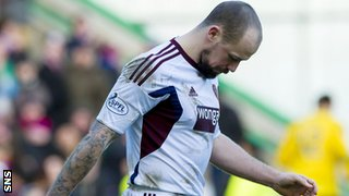 Hearts midfielder Jamie Hamill is dejected after seeing his penalty saved