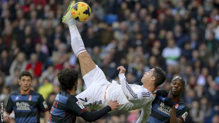 Real Madrid's Portuguese forward Cristiano Ronaldo (centre) kicks the ball during the Spanish league football match v FC Granada