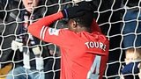 Liverpool defender Kolo Toure looks on after his mistake gifted West Brom an equaliser