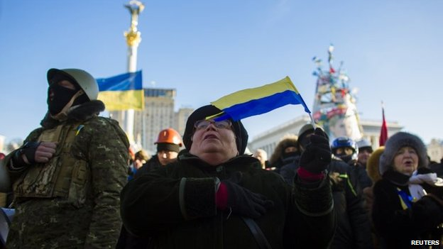 Anti-government protesters sing the Ukrainian national anthem during a rally at Independence Square in Kiev, February 2