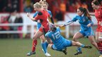 Wales' Elinor Snowsill is tackled by Michela Sillari during the Women's Six Nations match against Italy at the Talbot Athletic Ground. Italy came from behind to win 12-11