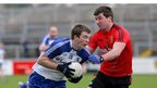 Monaghan's Jack McCarron wheels away from Down's Peter Turley as Down draw with Monaghan at Newry