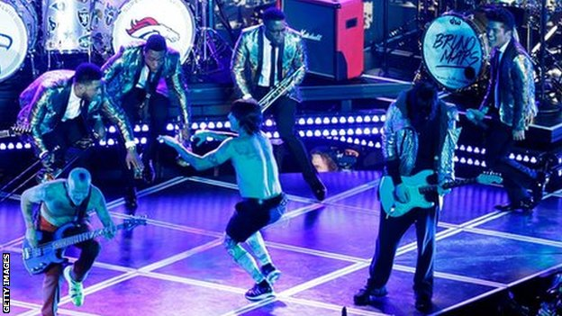 Bruno Mars (right) is joined by the Red Hot Chili Peppers in the Super Bowl half-time show