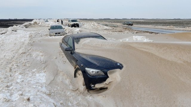 Vehicles are stuck in the snow on the road near the city of Backa Topola, northern Serbia