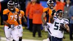 Seattle linebacker Malcolm Smith (right) returns Denver quarterback Peyton Manning's second interception of the night for a touchdown