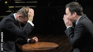 David Beckham (left) gets egg in his hair during a game an American chatshow