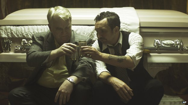 Philip Seymour Hoffman and Eddie Marsan, in a scene from the film, God's Pocket