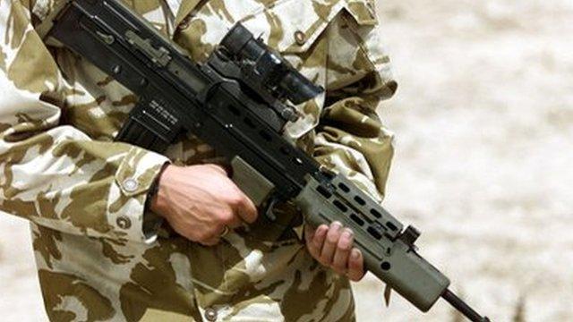 Serviceman with an SA80 rifle