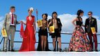 Couples partaking in the best-dressed competition at the J&B Met race in Cape Town (1 February 2014)