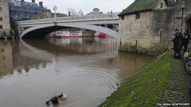Police divers carry on their search of the River Ouse near Lendal.