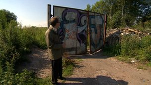 Man standing at an entrance to the former colliery site