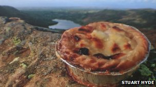 Pie on crag overlooking Lake District