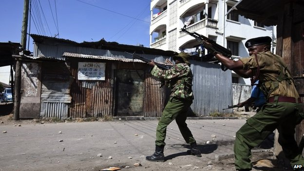 Police officers firing their guns in Mombasa