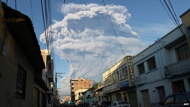 A cloud of ash and vapour spewed by the Tungurahua volcano can be seen from the city of Riobamba, Ecuador, on February 1, 2014