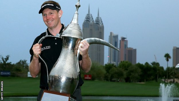 Stephen Gallacher lifts the trophy for the second year running
