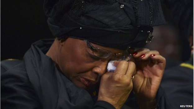 Graca Machel, the widow of former South African President Nelson Mandela, attends his funeral in his ancestral village of Qunu on 15 December 2013.