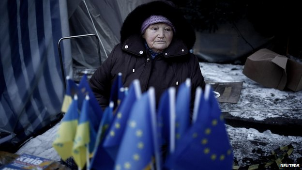 A street vendor sells flags of Ukraine and EU in Maidan Square in Kiev on 3 February 2014.