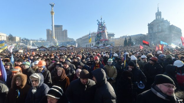 Anti-government protesters take part in a demo in Kiev on 2 February 2014