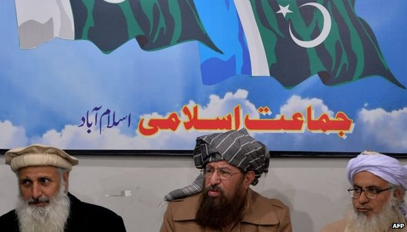 The chief cleric of Islamabad's Red Mosque, Maulana Abdul Aziz (right) and two senior religious party leaders, Maulana Sami-ul-Haq (centre) and Professor Ibrahim Khan hold a news conference in Islamabad on 3 February 2014