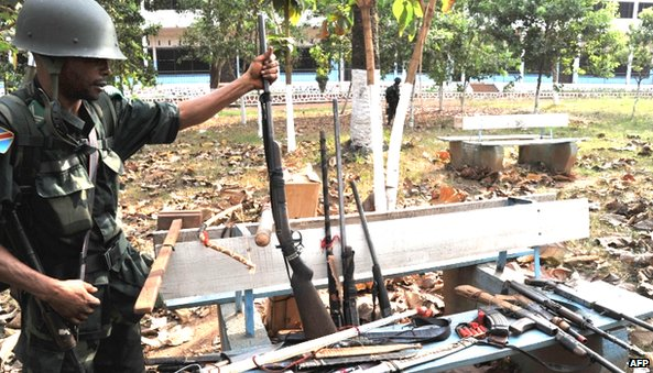 A Congolese peacekeeper displays various weapons seized from Anti-Balaka Christian militiamen in Bangui on 1 February 2014