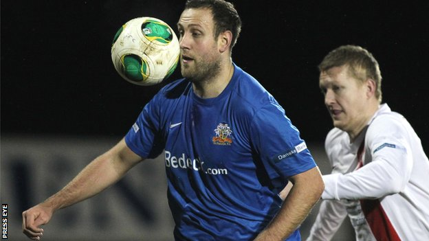 Glenavon striker Guy Bates shields the ball from David Armstrong