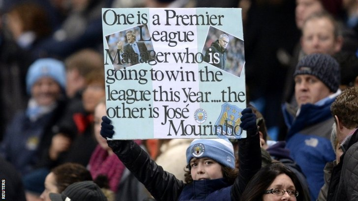 Man City fan holds up sign