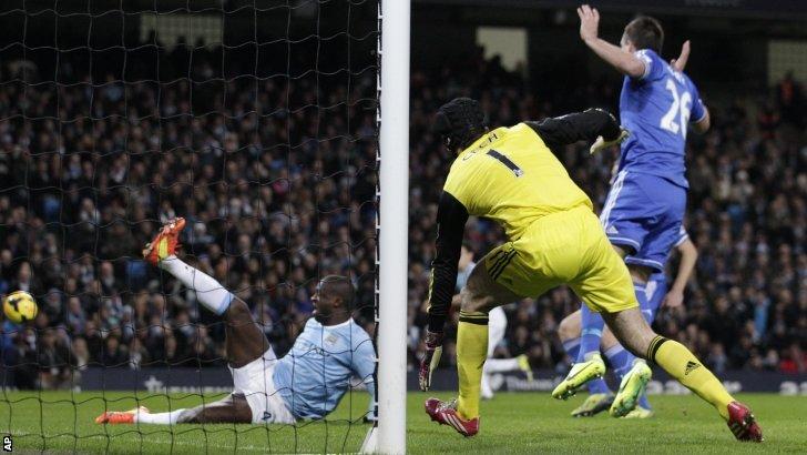 Yaya Toure slides for the ball