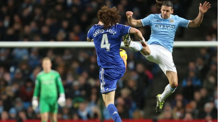 David Luiz and Martin Demechelis compete for the ball